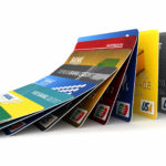 Credit cards in a row falling – credit card debt concept